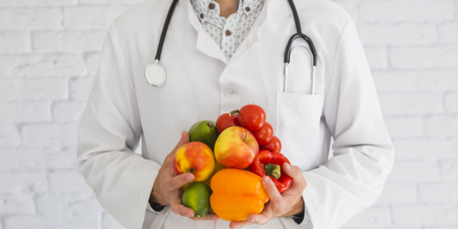 close-up-of-male-doctor-s-hand-holding-fresh-produce-healthy-fruit-and-vegetable_23-2147855415
